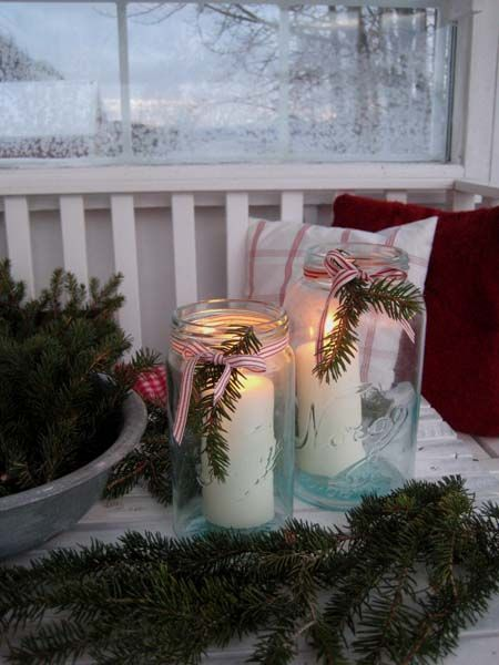 Mason jars, white candles, red & white ribbon, sprig of evergreen