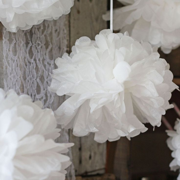 White paper poms are an easy and cost effective way to transform your wedding venue. Hang white paper poms from the ceiling of your reception venue, marquee or outside, group in clusters or hang individually on different lengths of ribbon. If you are having a sweetie buffet hang a cluster of white paper poms above it to make a lovely frame.  Paper poms can look fab attached to pew ends and chair backs too, or placed in bowls around your wedding venue.  About our white paper poms:  …