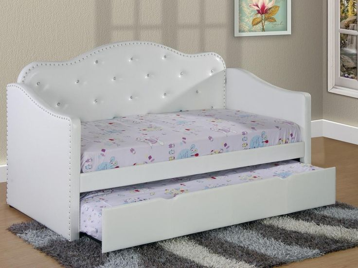 This twin trundle bed is a great addition to any bedroom! Upholstered with faux leather, this bed is a perfect addition to any bedroom. The pull out trundle offers additional sleeping space, and spaci