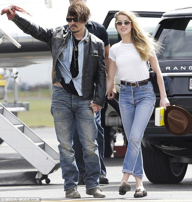 Together again: Johnny Depp and Amber Heard held hands as they arrived in Brisbane, Austra...