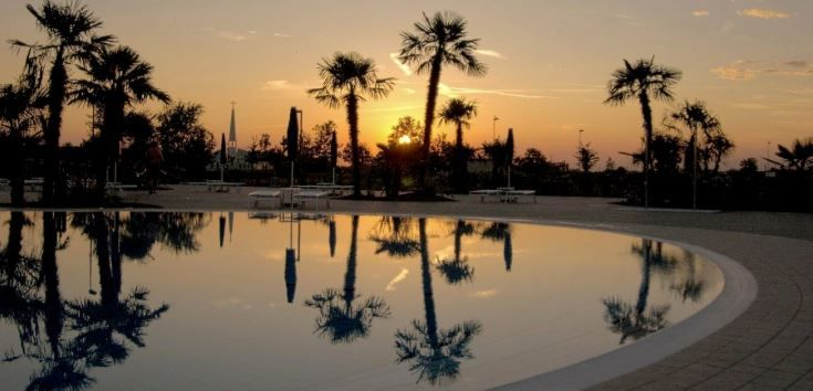 The sunset is reflected in our pool #caorle. #italy