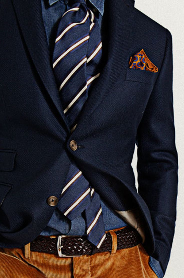 Corduroy pants, navy blue sort coat, striped tie and blue button down shirt