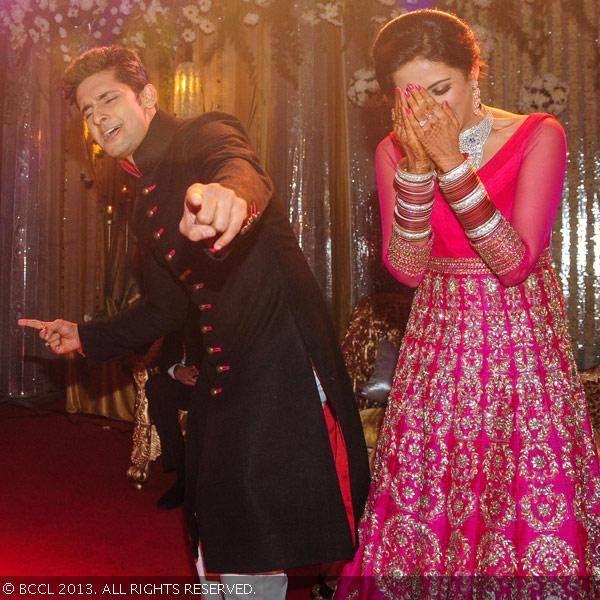Ravi Dubey and Sargun Mehta shake a leg during their wedding reception, held in Mumbai, on December 13, 2013.