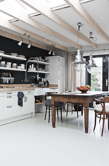 Great rustic kitchen look, love these industrial pendants, white floor and the black wall