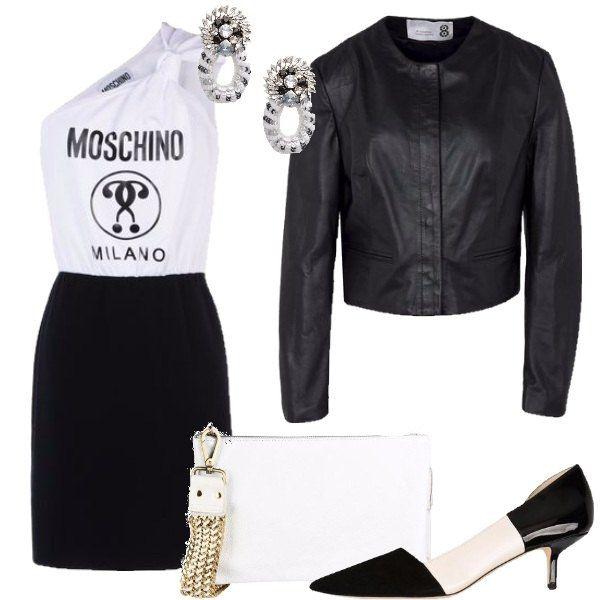 Un outfit basato sul bianco e nero con un abitino monospalla del noto brand, un giubbotto in pelle nera, décolleté bicolor con piccolo tacco, pochette bianco optical ed infine orecchini dall'aria vintage.