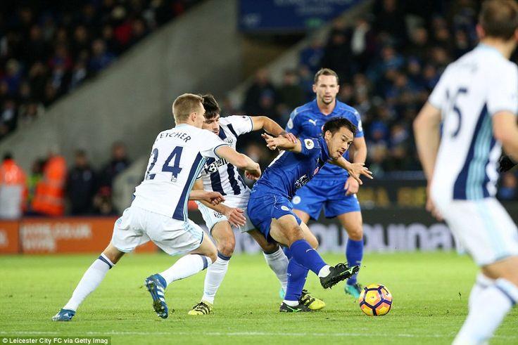 Leicester's Japan international Shinji Okazaki finds himself under pressure from Yacob and Darren Fletcher