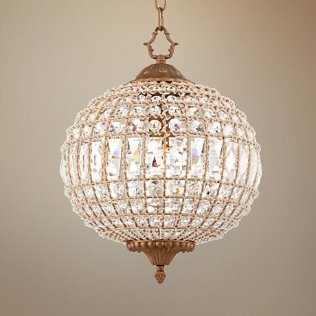 Bring sparkle to your space with this glamorous crystal globe chandelier in  antique gold finish.