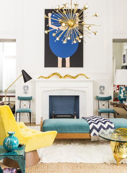 Living Room - A Sputnik chandelier, a bench with a chevron throw, an armchair and a glass-topped table