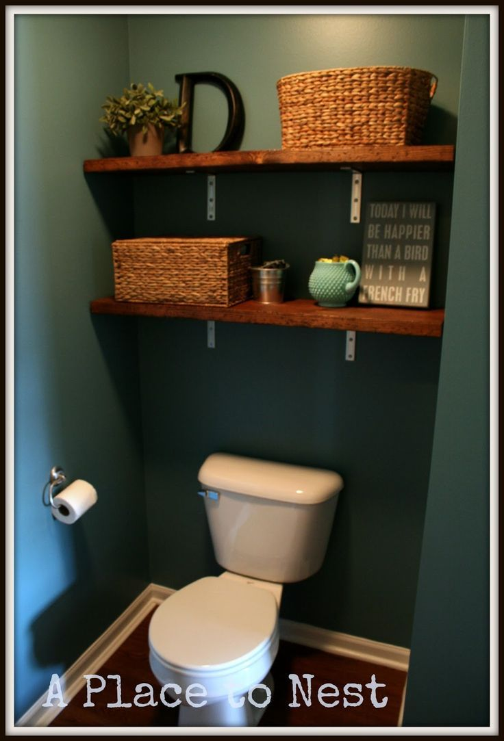 I love the shelves over the toilet idea.  Great if you have a small bathroom! Might need to take down the small little cabinet in our bathroom