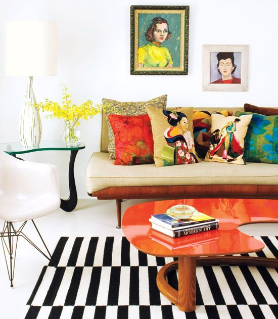 love the contrast of the stripes with the bold pillows and white walls.