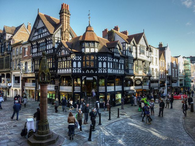 10 Best Places to Visit in the UK  Not far from the border with Wales, the city of Chester lies on the River Dee in Cheshire, England. The city is more than 2,000 years old, which means there is plenty of history, culture and architecture on hand spanning several eras. Distinctive 19th century black-and-white revival architecture can be found throughout the city. The Roman and medieval walls encircling the city are one of Chester's biggest tourist attractions.