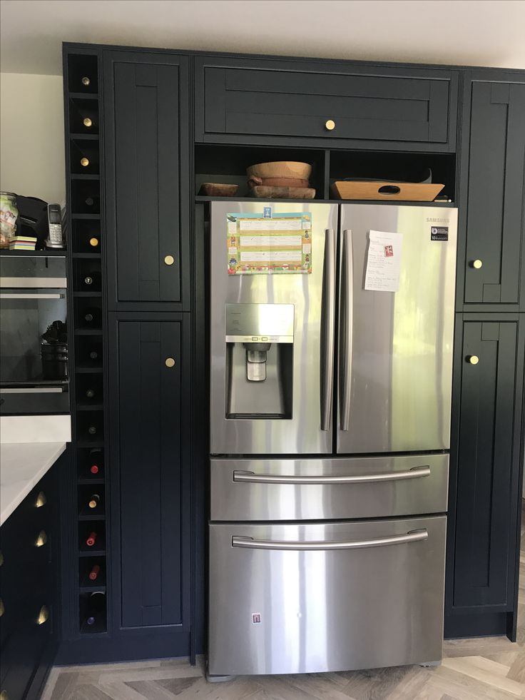 Navy in frame kitchen, American style fridge freezer with bespoke wine rack. Installation by www.nichehouse.co.uk