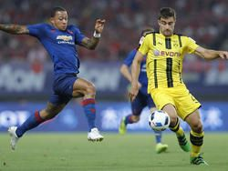 Mourinho's United stunned 4-1 by Dortmund in China