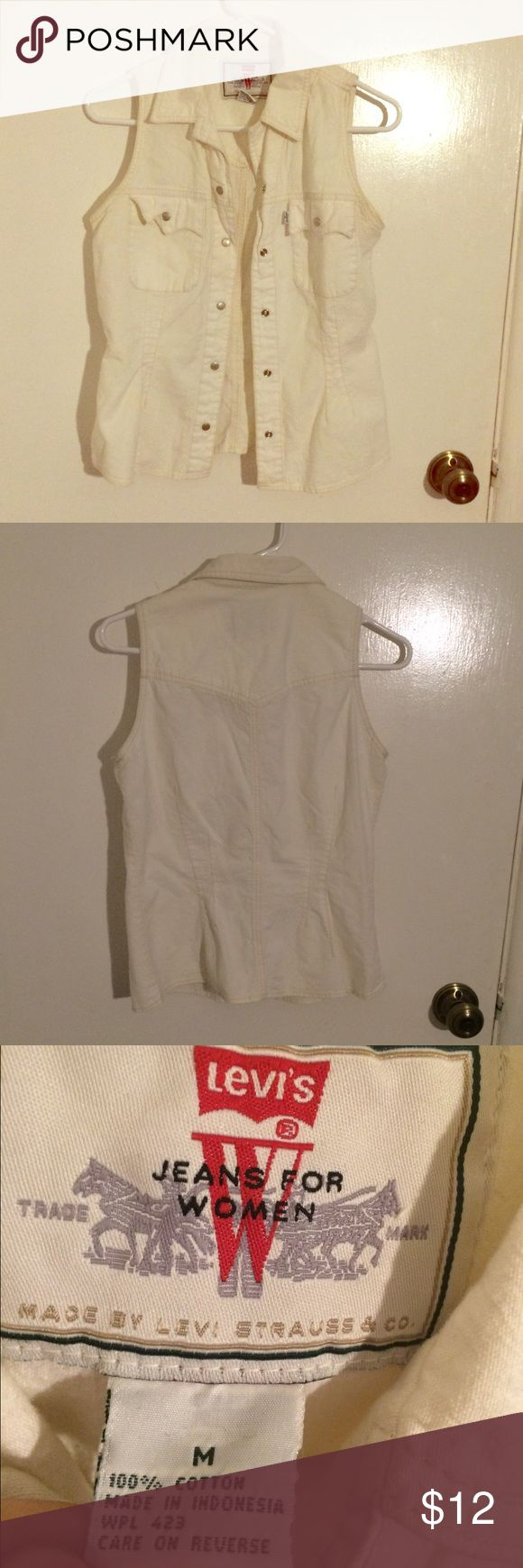 Levi's White Denim Vest Levi's Jeans for Women size medium 100% cotton white denim sleeveless collared button down best with silver tone snap button closures and two breast pockets that also have silver snap button closures with a flap. Gently used with some wear to the fabric but nothing very noticeable. There are no stains, rips, holes, tears, odors, or missing buttons. In good condition. Fabric has been washed many times and looks a bit different than when first purchased which is why…