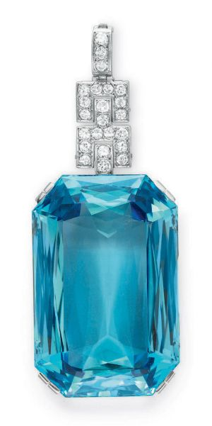 AN ART DECO AQUAMARINE AND DIAMOND PENDANT Set with a cut-cornered rectangular-cut aquamarine, weighing approximately 190.74 carats, to the circular-cut diamond links and bail, mounted in platinum, circa 1925, with French assay marks and maker's mark