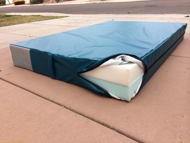 Gymnastics mat You could use a few sheets of foam