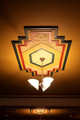 They don't make 'em like this anymore. Art Deco architectural ceiling relief and lighting circa 1930's.