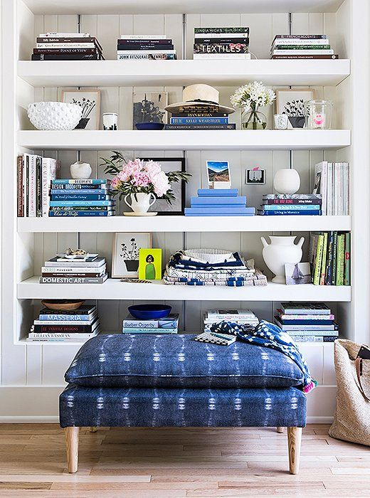 """""""The indigo bench that I have in front of my bookshelf is my favorite,"""" Michelle says ofher new collection of furniture. """"I'm kind of obsessed with it."""""""