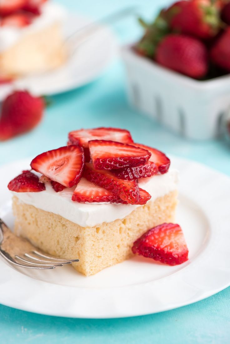 Tres Leches Cake - Treat yourself this summer to a piece of this sweet and refreshing Tres Leches Cake topped with fresh berries!