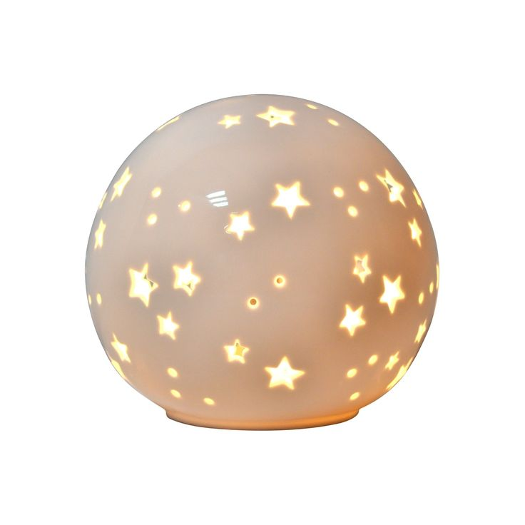 Pillowfort's Starry Globe Night-Light makes every night a starry, starry night. Made of ceramic with a glossy white finish, it gives off a comforting glow and projects stars onto nearby surfaces. This star night-light works well on a nightstand or dresser.