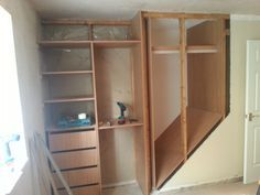 using the space above the staircase for a custom closet