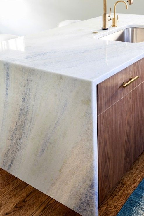 Had to zoom in on this gorgeous walnut kitchen island topped with Aquias Blue Quartzite! | Design Manifest