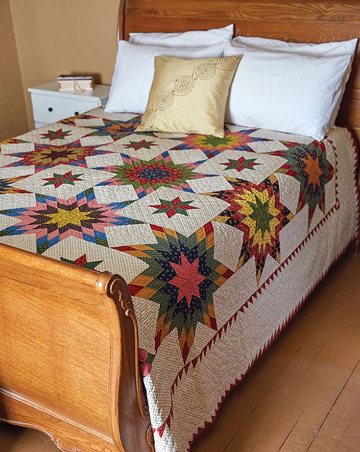 Harvest Sun is a spectacular king-size quilt that uses lots of reproduction prints. Use strip piecing for the stars and an easy technique for making eight triangle-squares at a time for the sawtooth border. This challenging bed-size quilt takes some time to make, but it's worth every minute!