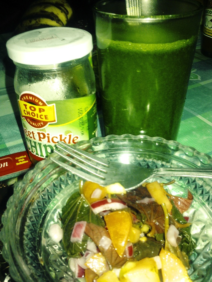 Since I can't stop myself on eating my mom let me eat this.     Pickles, Sweet potato tops with tomatoes and onions, and barley juice.    #HealthyLiving #Greens #Diet