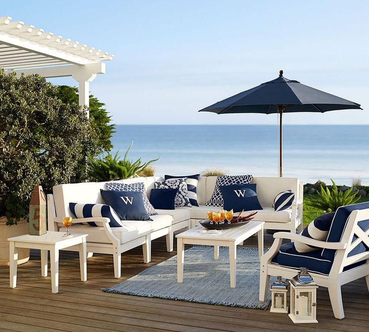 Preppy navy and white patio furniture make for the perfect seaside setting. - 25+ Best Ideas About White Patio Furniture On Pinterest Patio