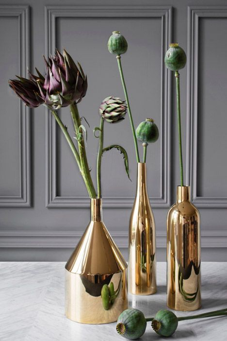 These brass vases look like they're straight out of a gorgeous still life painting.