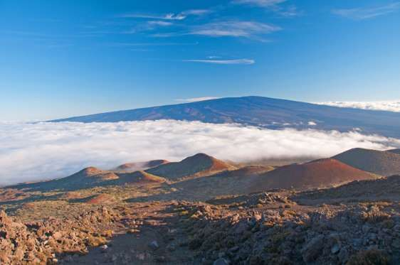 """MAUNA LOA, HAWAII Mauna Loa means """"Long Mountain."""" It is the largest volcano in Hawaii and one of the most active volcanoes in the world. Eruptions are large and produce rivers of lava that have threatened nearby towns. The first-ever eruption was in 1832 and it last erupted in 1984."""