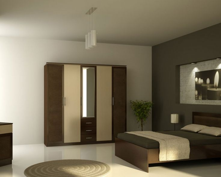 wooden almirah designs with sunmica bed with round rugs