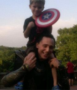 """Story of a Five Year-Old Avenger, Meeting the Avengers    """"Hi, Loki!"""" my wife said (100% sure she didn't know Tom Hiddleston's name). """"Can my son get a picture with you?"""" she asked. """"Can I put him on my shoulders?"""" Loki asks. """"Um … okay?"""" is Jill's response and hands Tom Hiddleston our son. He hoists him up on to his shoulders (I should mention that this guy is like 8 feet tall), and my wife takes out her Blackberry. Hiddleston puts Edison down, shakes his hand and says goodbye…"""