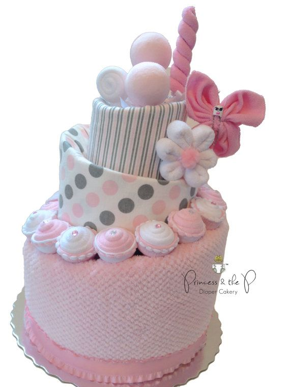 The Diaper Cake... Re-imagined!! My Baby Sweet Treats Topsy Turvy Diaper cake is a modern twist to the classic baby girl Diaper Cake. It