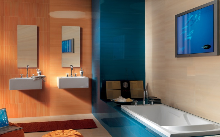 Collection: FAP Idea / Arancio   These oversized, rectangular tiles come in a wide array of colors which can be mixed beautifully, as shown in this bold bathroom setup.