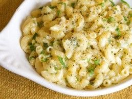 Ingredients    ½	a head of cauliflower  8	 oz. Cheddar cheese  4	 oz. Parmesan cheese  A small bunch of fresh Italian parsley  Sea salt  1	 lb. dried macaroni (elbows)  1	 cup crème fraîche or sour cream    Directions    1. To prepare your
