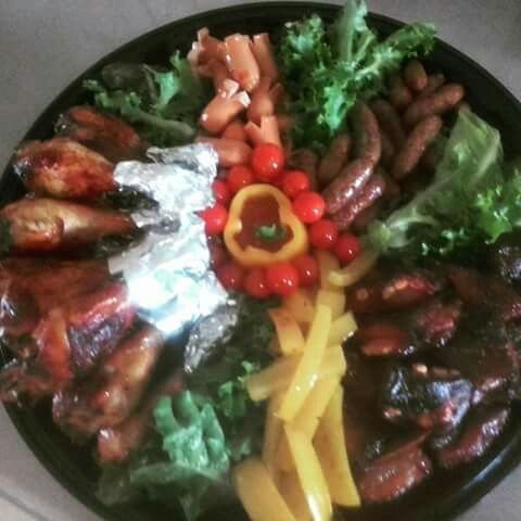 Meaty platter. Chicken drums, sausages and port giblets!