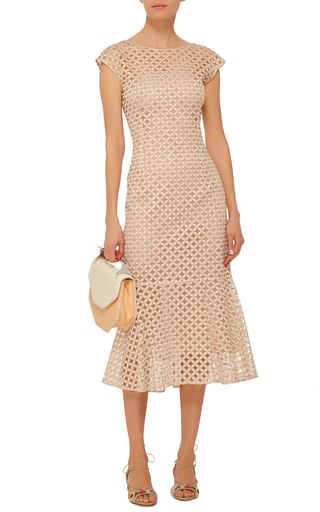 This dress by **Luisa Beccaria** stays true to their floral romanticism this season with an all-over floral eyelet construction. The neutral hue and jewel neckline make this piece an easy transition from day to night.