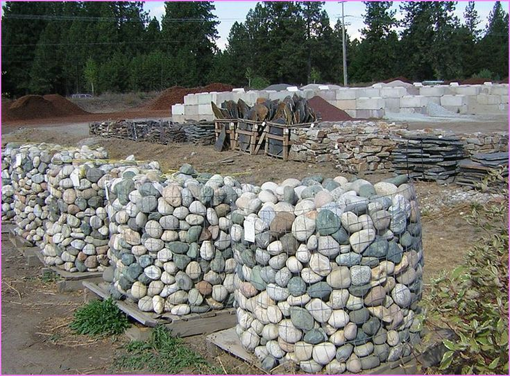 Landscaping with river rock on a hill front yard for Landscaping rocks adelaide