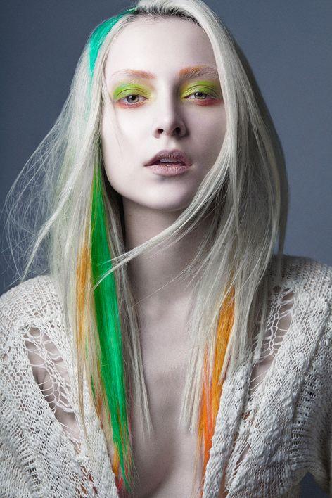 Streaked green orange dyed hair