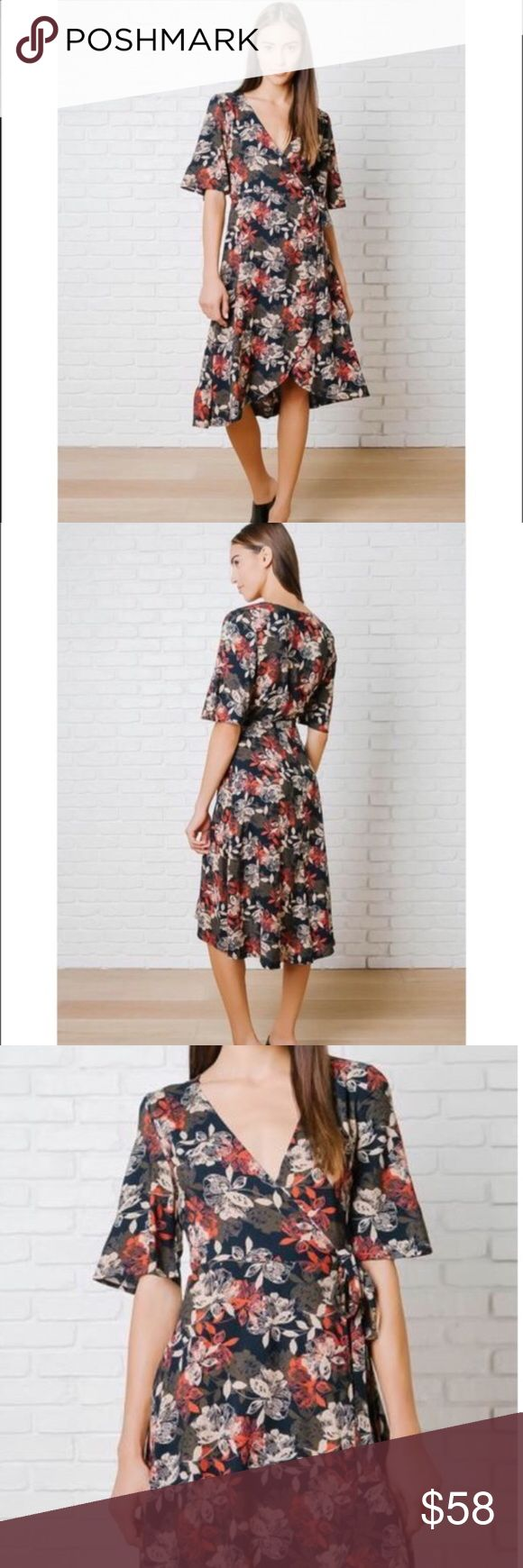 "🆕Sophisticated style wrap dress ❤️ A sophisticated style for your wardrobe. This navy-hued frock is patterned w/a floral design in cream, red,brown hues, & has a V-cut neckline for a flirty hint of skin.Its flowy sleeves add a playful vibe, & it features an adjustable tie @ the waist for the perfect fit. It is finished w/a slightly asymmetrical hemline.100% Rayon Measurements 36"" bust 39"" from top of shoulder (to shortest point) 45"" from top of shoulder (to longest point) Model Stats…"