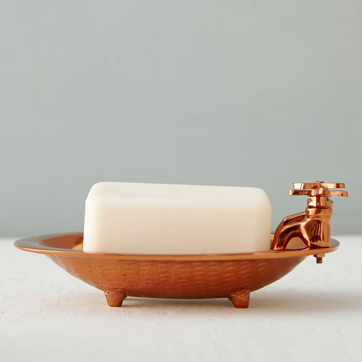 "Playfully shaped to resemble an old-fashioned bathtub, this polished copper soap dish with built-in drainage holes offers a whimsical place to stow your favorite soaps.- Brass, copper finish- Hand wash- Two drainage holes- Imported2.2""H, 5.75""W, 3.6""L, 1""D"