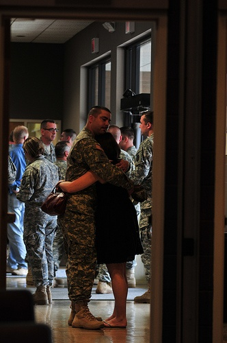 Sylva, N.C. – A Soldier hugs his wife after the conclusion of the 210th Military Police Company deployment ceremony on April 17, 2013 at the Southwestern Community College auditorium in Sylva, N.C.  Photo by Tech. Sgt. Brian E. Christiansen.