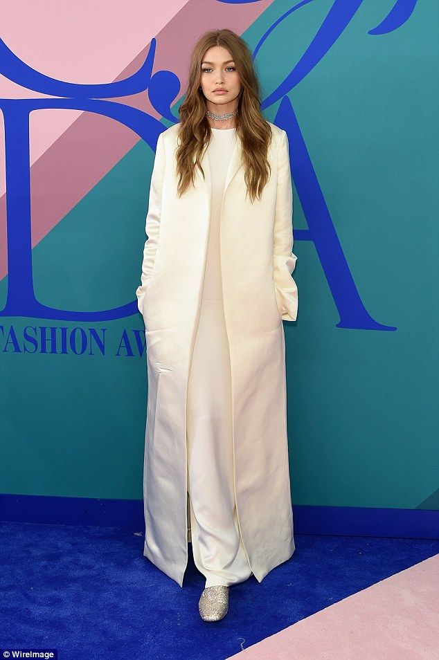 Gigi Hadid, 22, opted for an all-white silk ensemble for Monday night's CFDA Fashion Award...