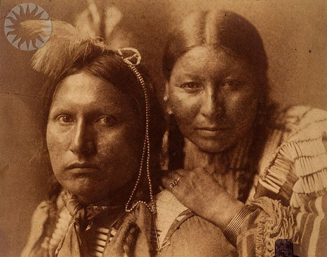 Sioux man and woman looking at camera, woman with left hand on man's shoulder, 1898, Gertrude Käsebier