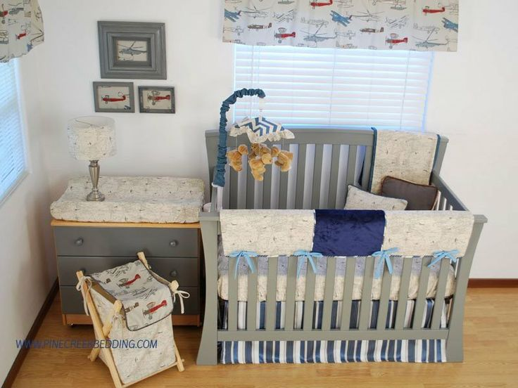 Map print crib bedding with navy and blue and red for World themed bedding