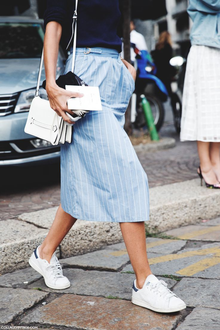 All white trainers with a light blue midi-skirt.