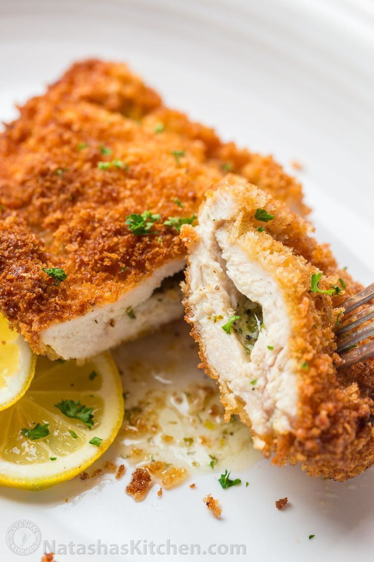 It's easier than ever to make this Chicken Kiev recipe. Slice through the crisp exterior of juicy Chicken Kiev and you'll get a stream of hot garlic butter. | natashaskitchen.com
