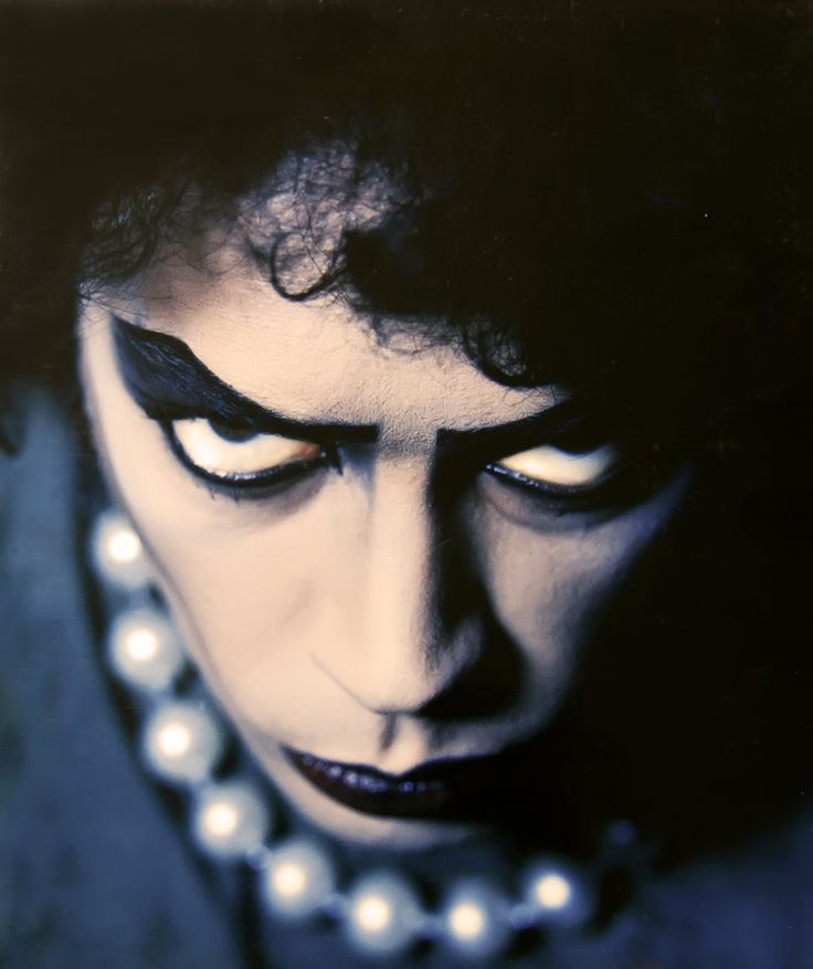 Dramatic portrait of Tim Curry as Dr. Frank-N-Furter, taken by Mick Rock.  This photo has seen recent use on the front cover of Rocky Horror - The Book and the inside cover of the 25th Anniversary DVD.