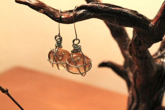http://www.etsy.com/listing/166016268/clear-amber-entangled-glass-stone